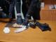 carabinieri con alcuni reperti sul tavolo