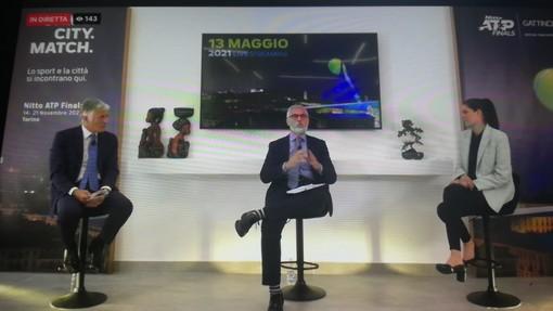 Appendino Gattinoni e moderatore sul palco
